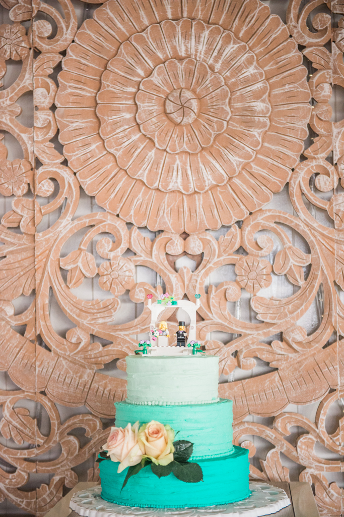 Mint green ombre wedding cake with a LEGO cake topper and buttercream