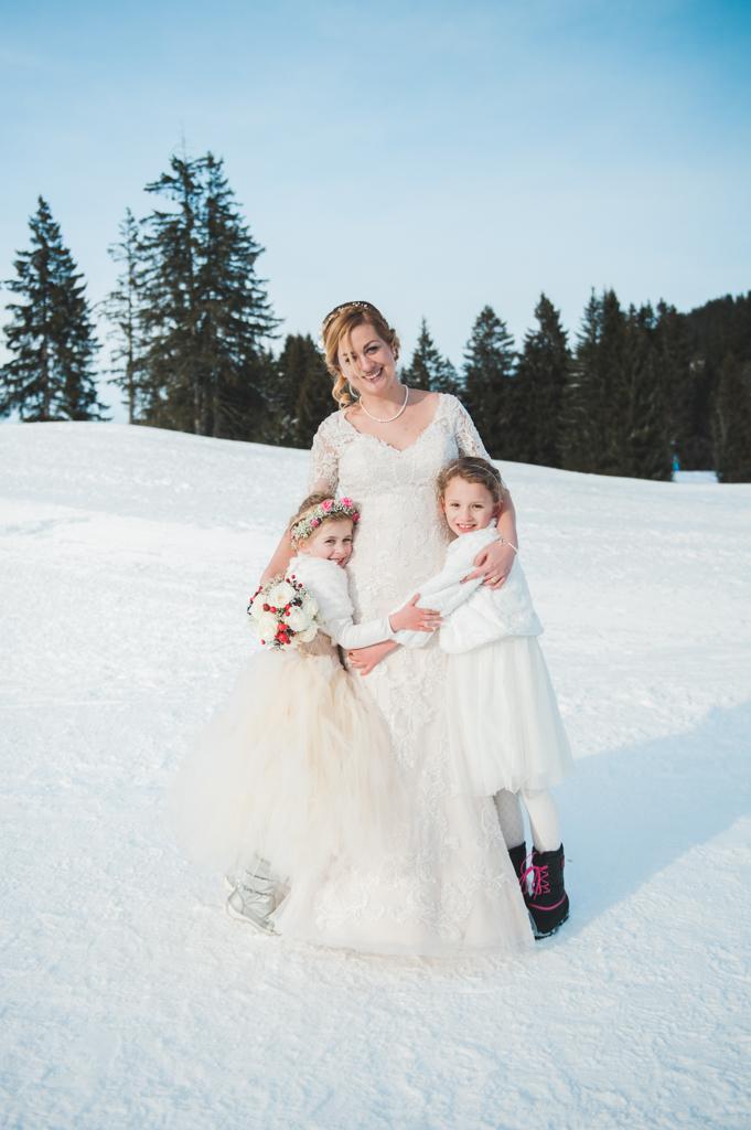 A bride with her flower girls at a winter wedding in Tyrol in Austria