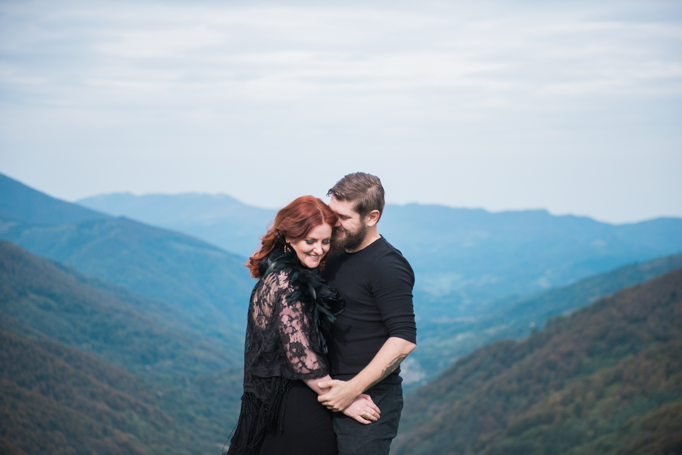 Tattoed man and woman on top of a mountain in the French Pyrenees during a photo shoot in an elopement setting