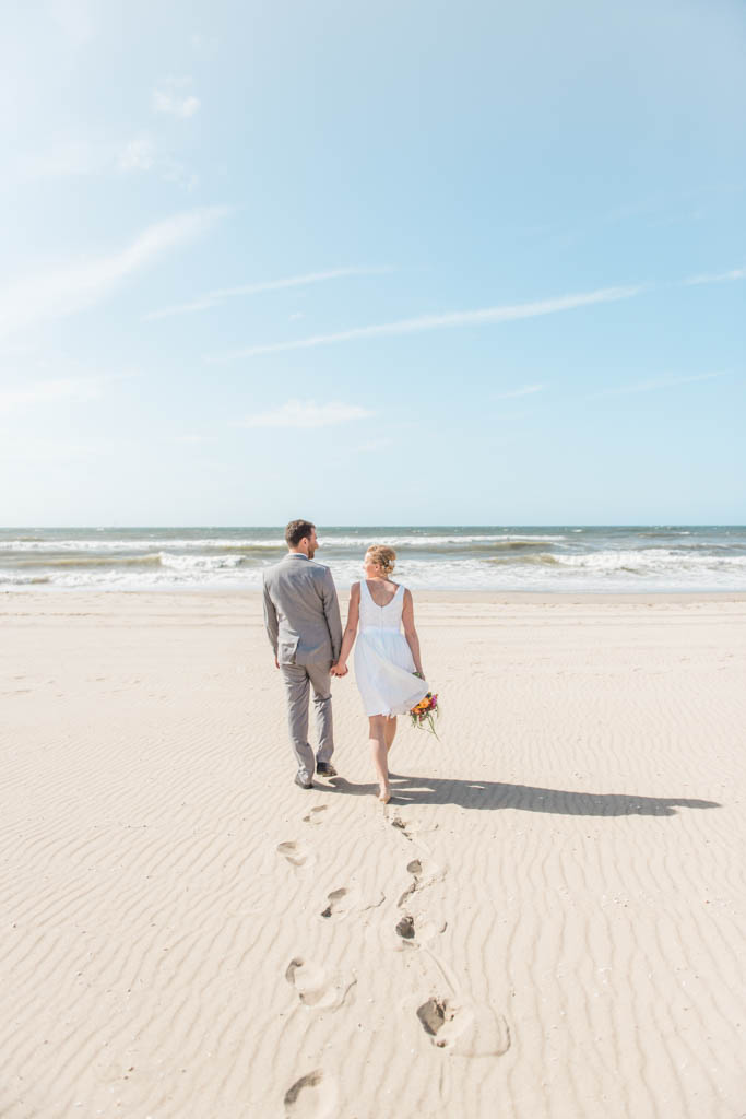 A couple walking towards the North Sea in Kijkduin in The Hague in The Netherlands