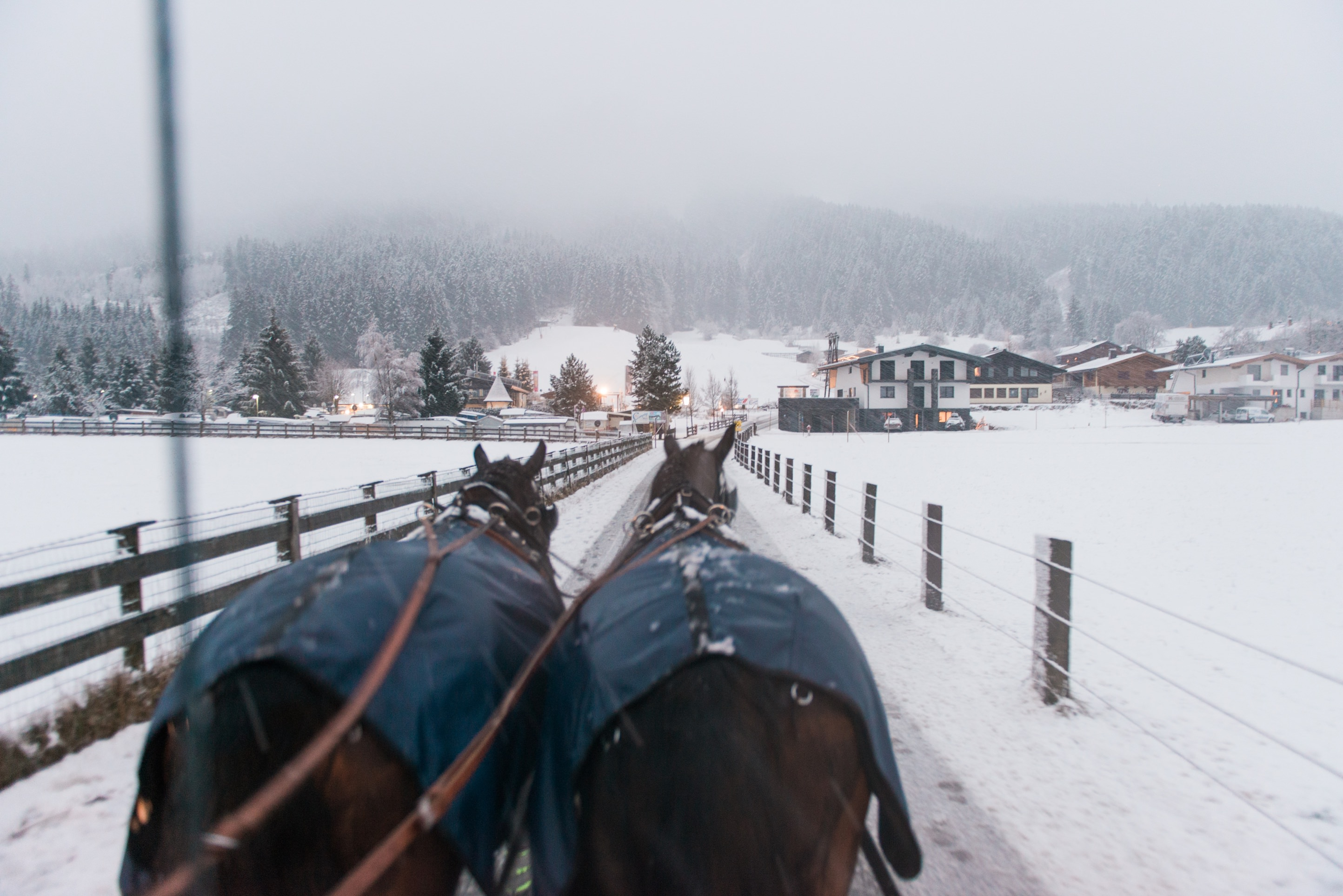 St. Moritz Trouwfotograaf - View of a village in Brixen from out of a horse drawn carriage