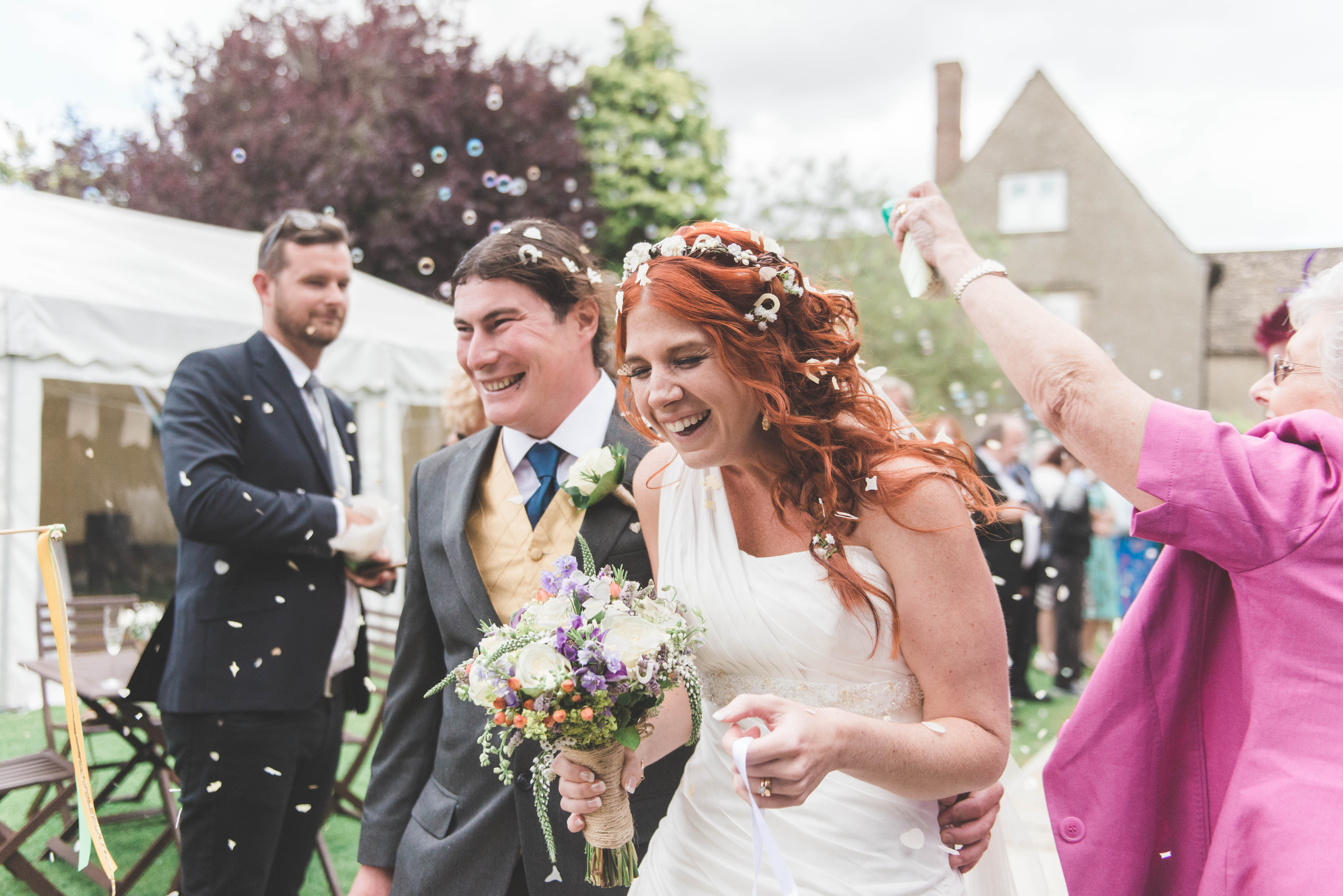 Bride and groom in a confetti shot. Photographed by a The Hague wedding photographer.