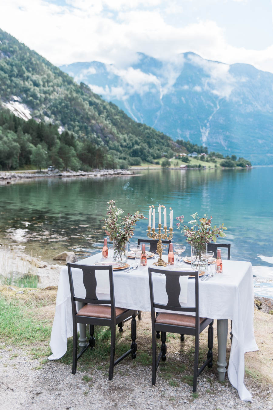 A beautiful table set in a fjord in Norway, styled by Lisa Land of Norwegian Wedding Magazine