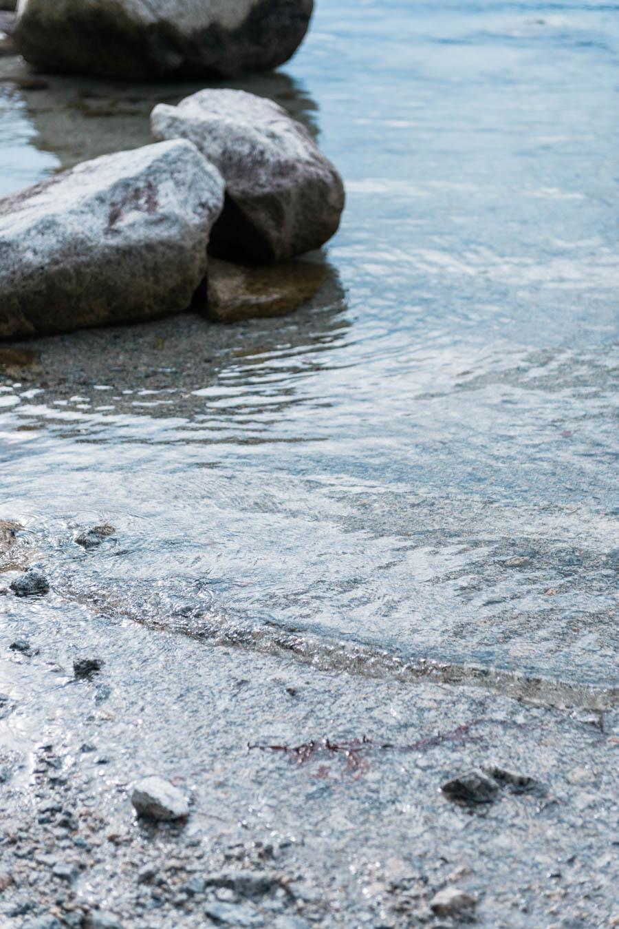 Stones and flowing water in a fjord in Eidfjord in Hardanger in Norway