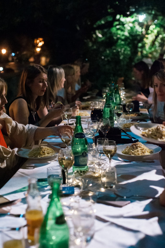 Dinner at a long table outside at the Cilento coast in Italy