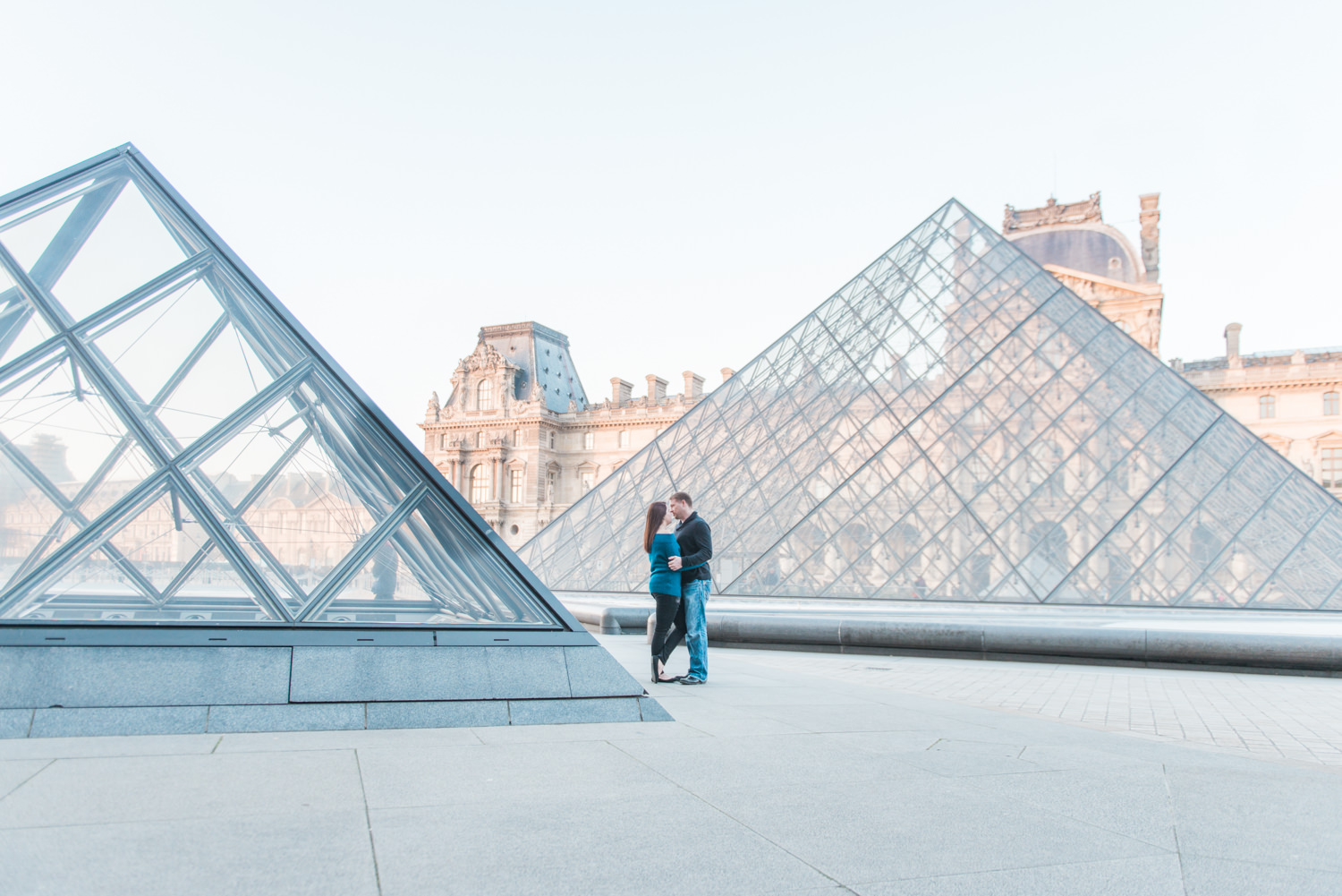 Couple on the square of Louvre in Paris