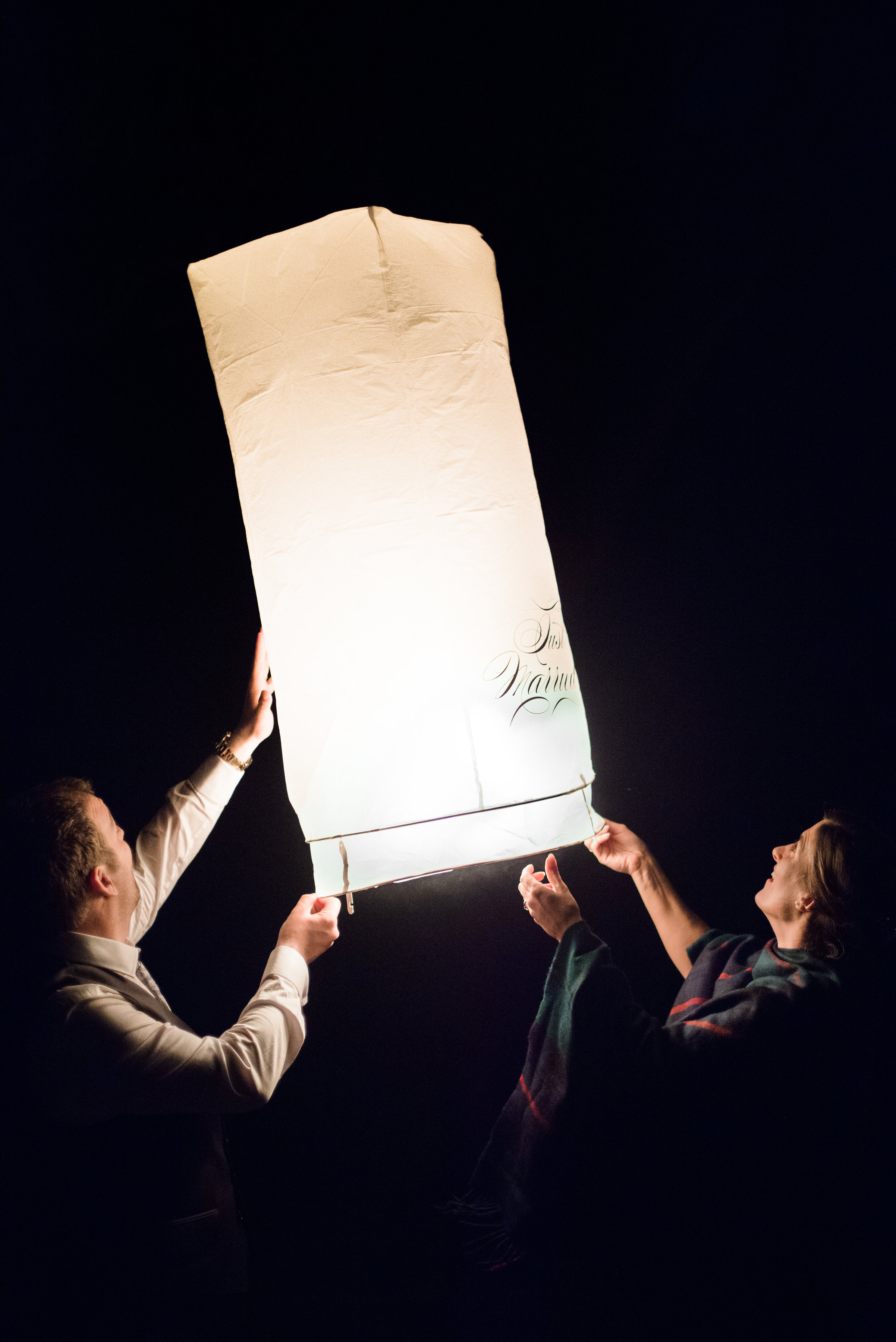 Sky lantern photographed at a destination wedding in Scotland