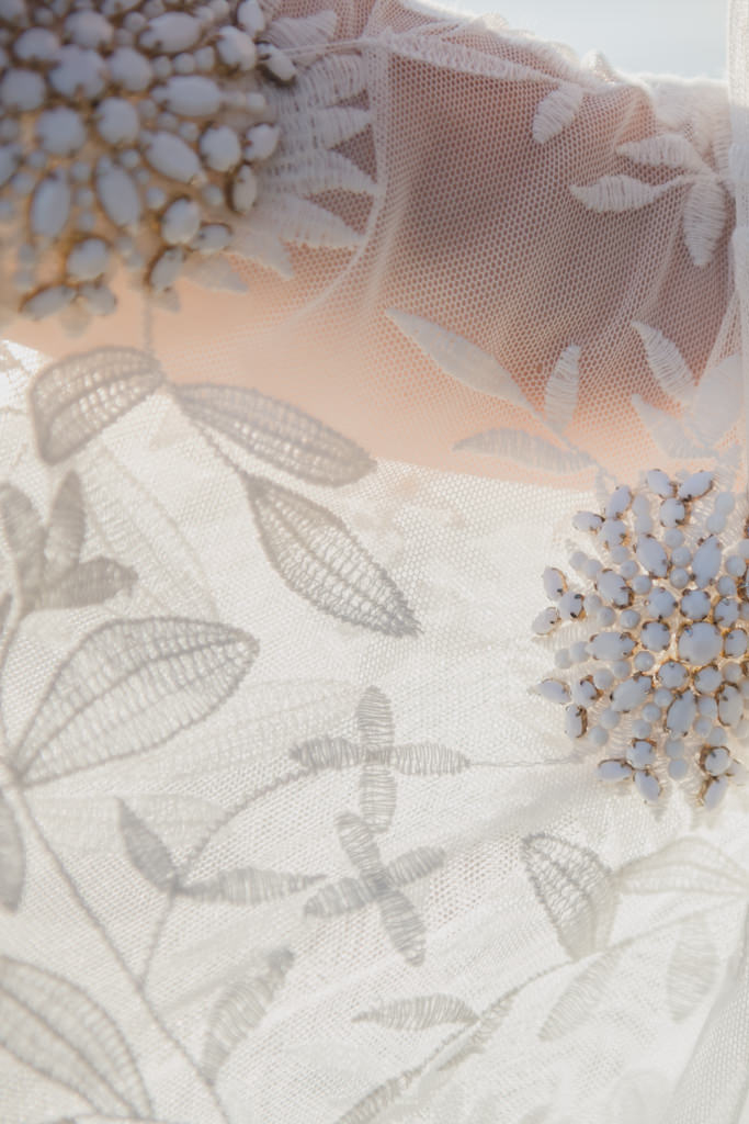 Detail of a Rue the Seine gown at a destination wedding in Greece