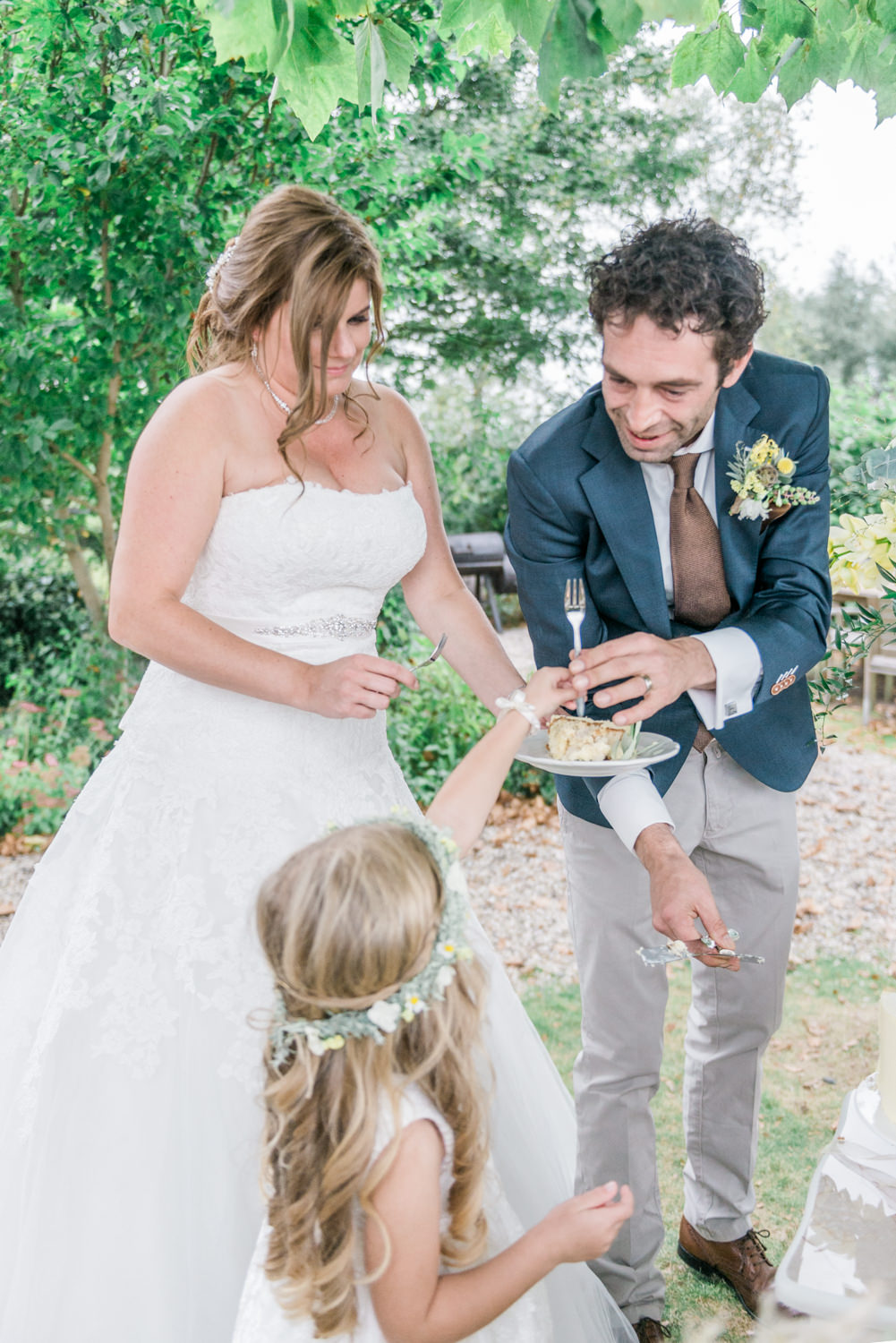 Cutting the cake at a destination wedding in Greece