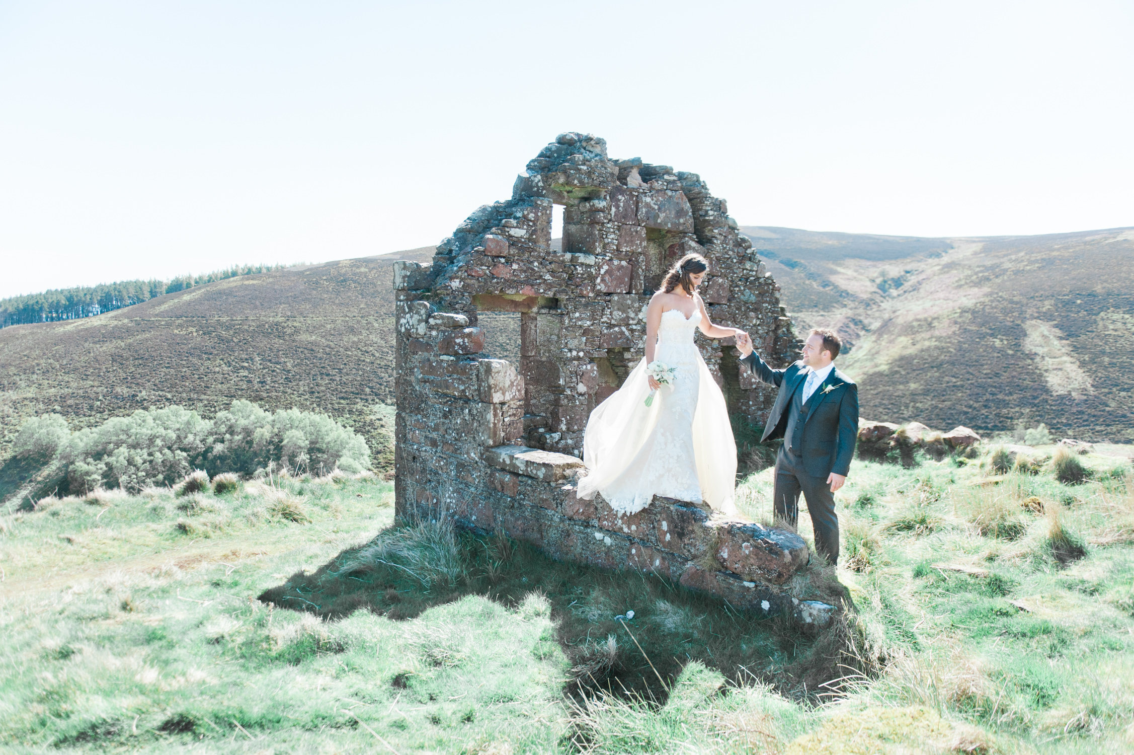 A bride and groom during their wedding photo shoot at a ruin in Scotland