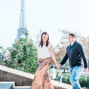 A couple on some steps near the Eiffel tower in Paris photographed by a wedding photographer