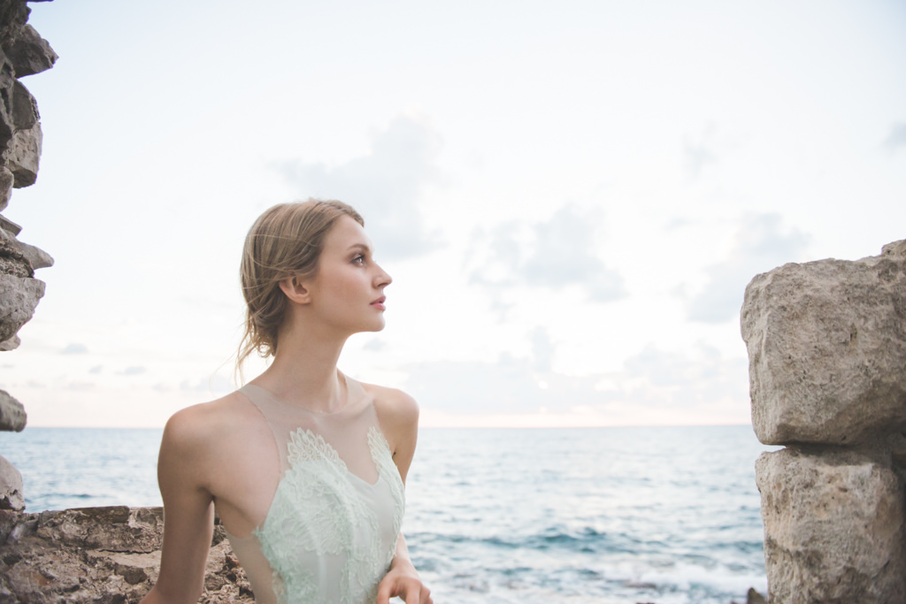 Destination wedding Greece: A bride in a tower during a bridal photo session on Santorini