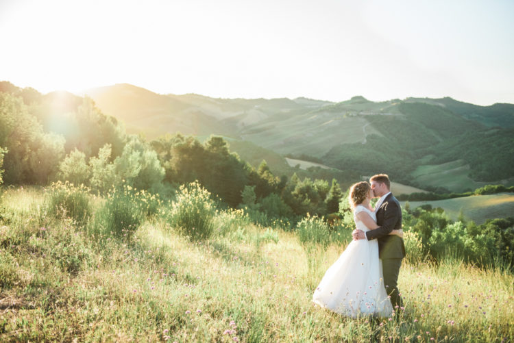 A bride and groom captured during golden hour in Le Marche in Italy