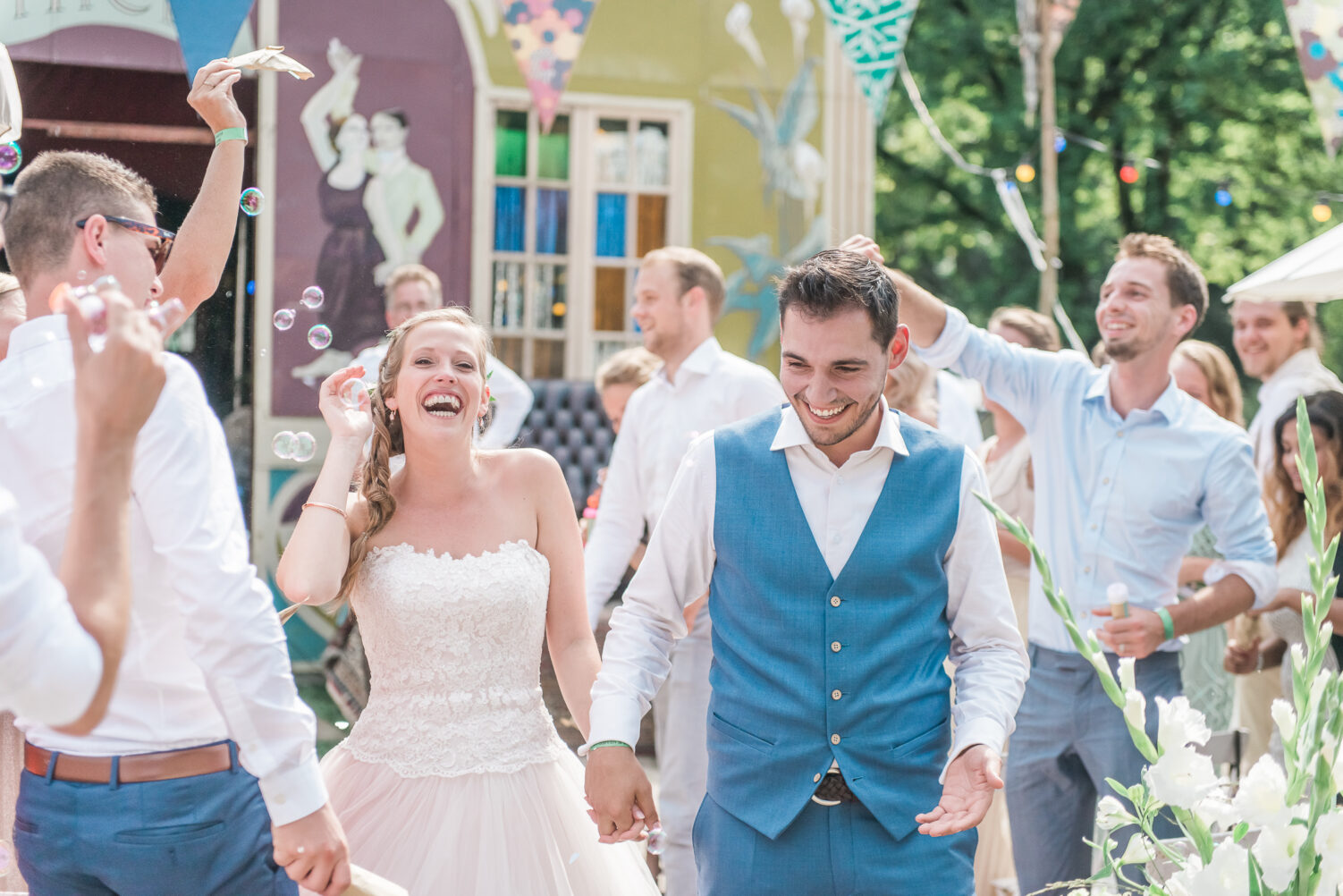 Confetti shot of the bride and groom coming out of their wedding ceremony