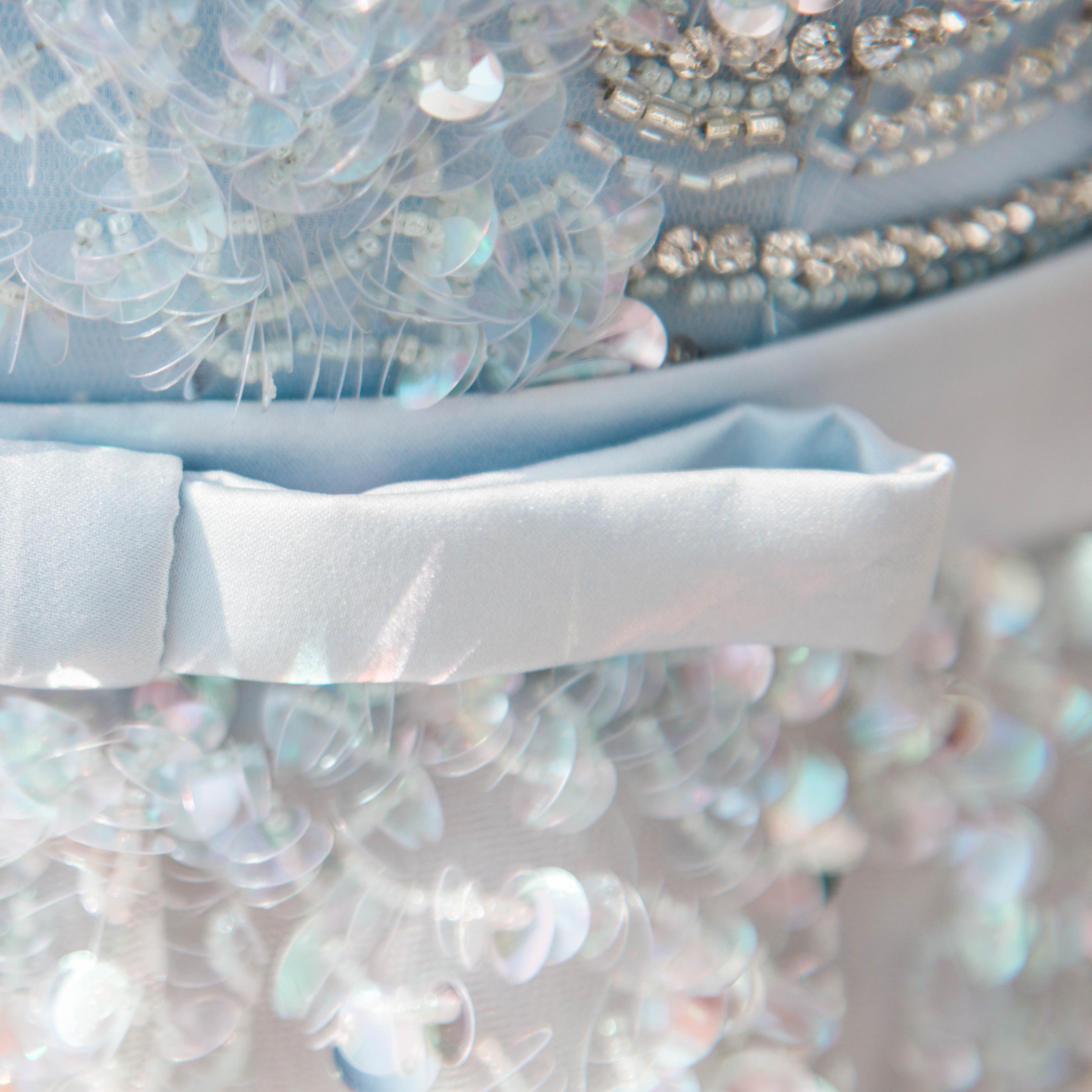 Detail of a sequined Unielle Couture wedding dress