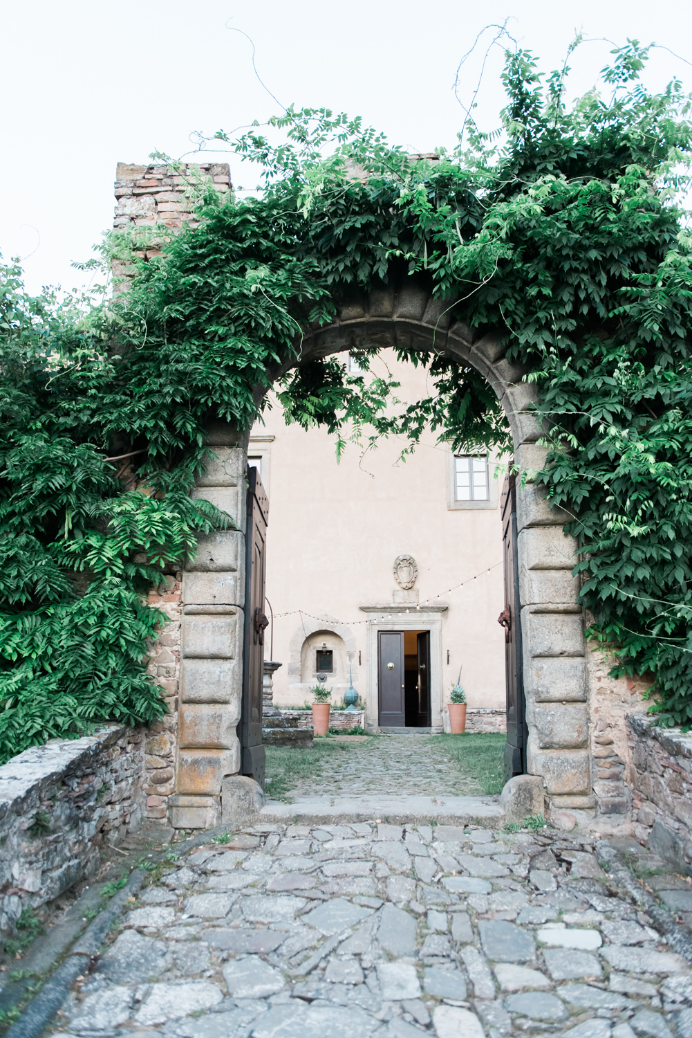 One of the gates of Castello di Potentino shot by a destination wedding photographer in Italy