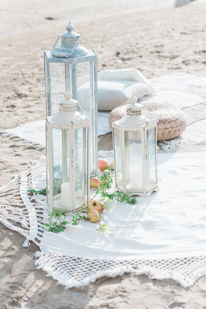 Lanterns at a beach wedding in the Peloponnesus in Greece, shot by a destination wedding photographer