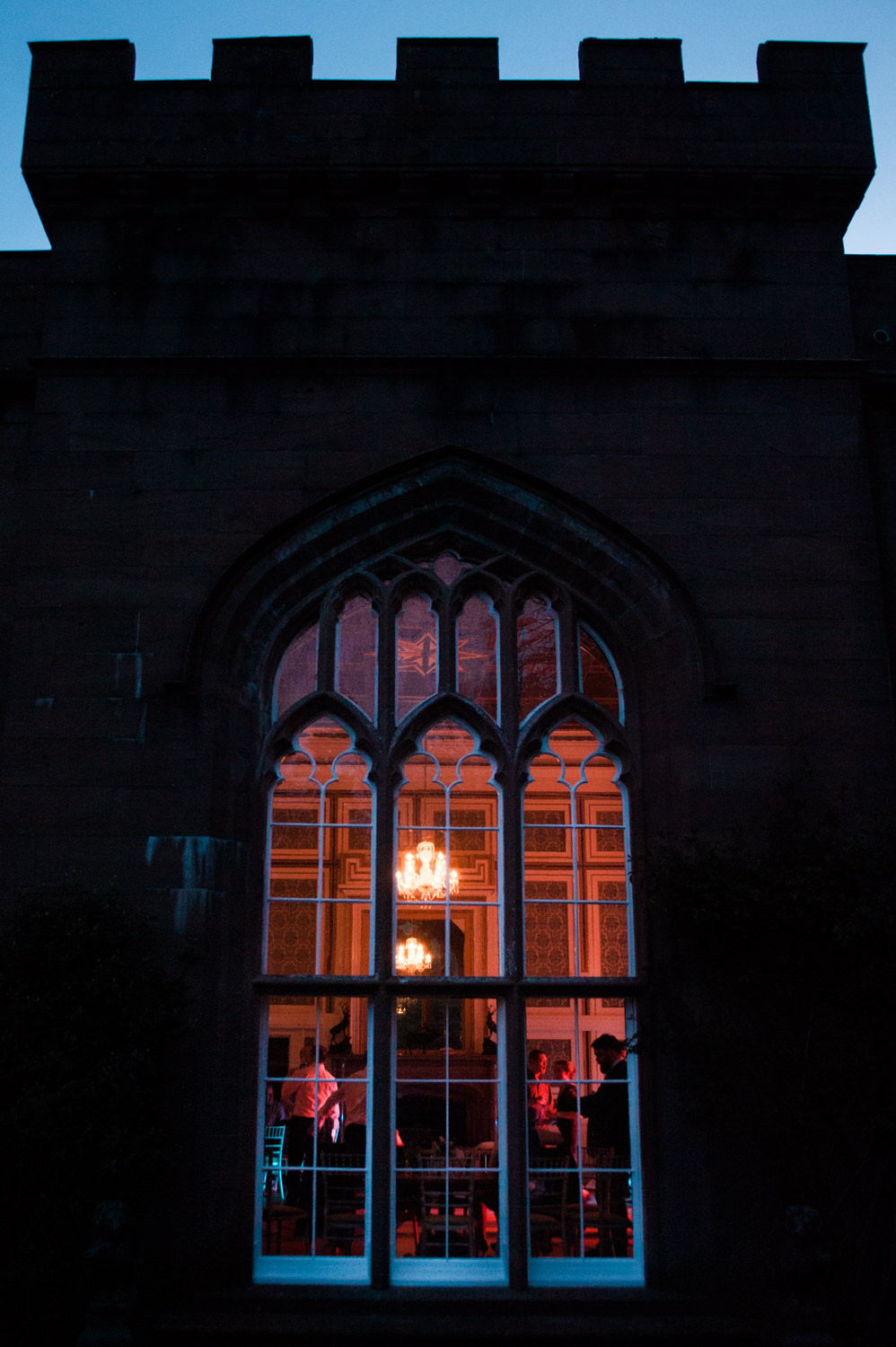 Window of Drumtochty Castle in the dark during a wedding party
