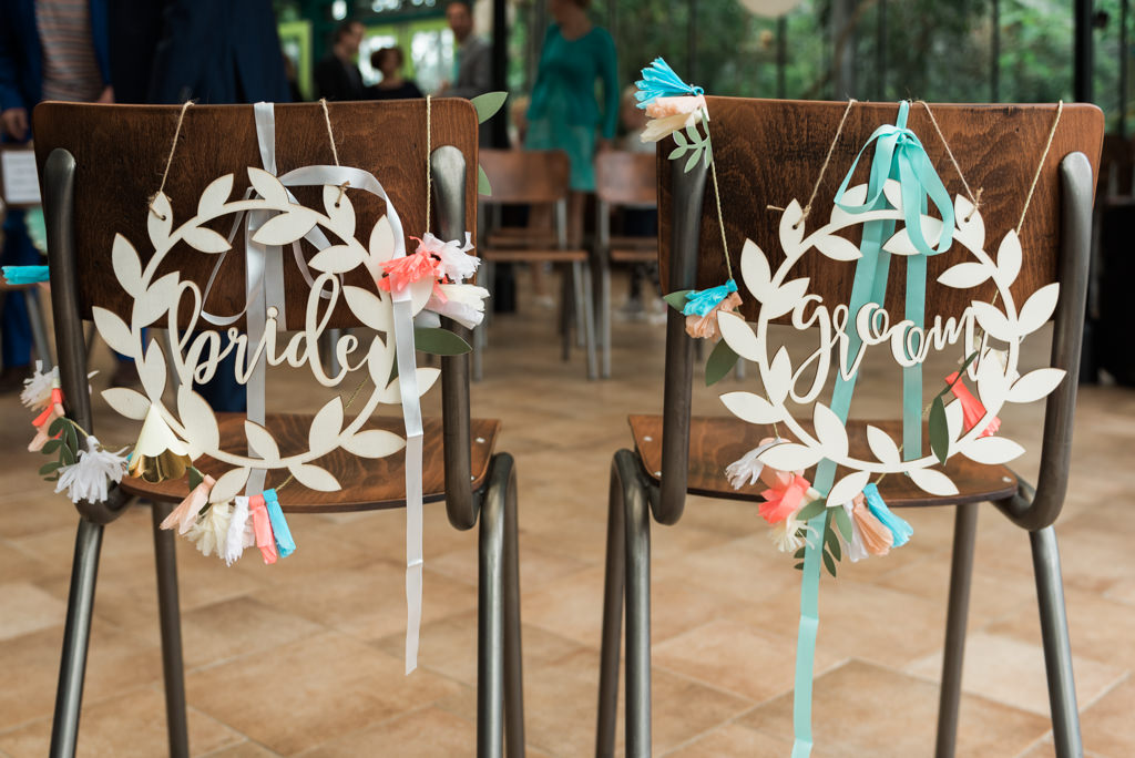 Bride and groom chair hangers at a botanical wedding captured by a wedding photographer in Utrecht