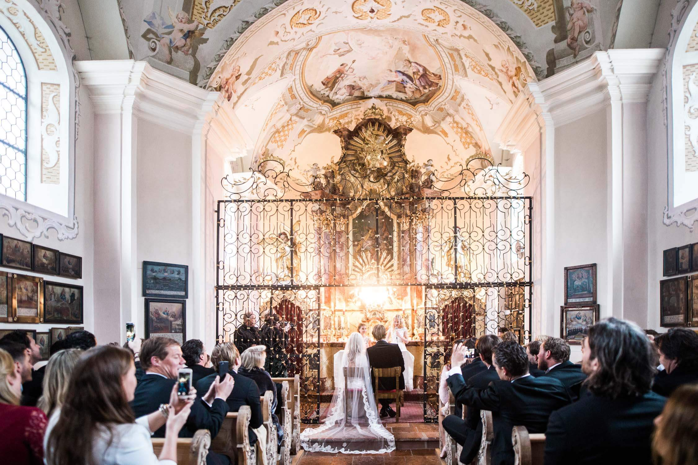 Bride and groom getting married in a chapel, captured by an English speaking photographer
