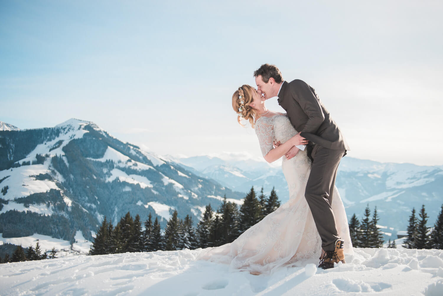 Bride and groom on a Tyrolean mountain in Austria