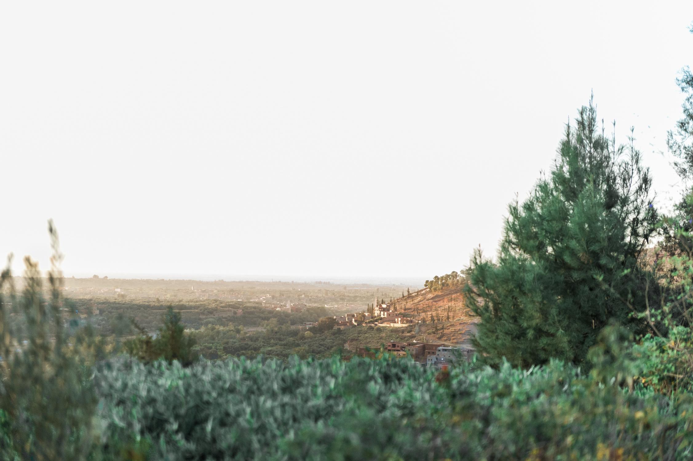 The view over Marrakech captured from Kasbah bap Ourika by an international award-winning wedding photographer