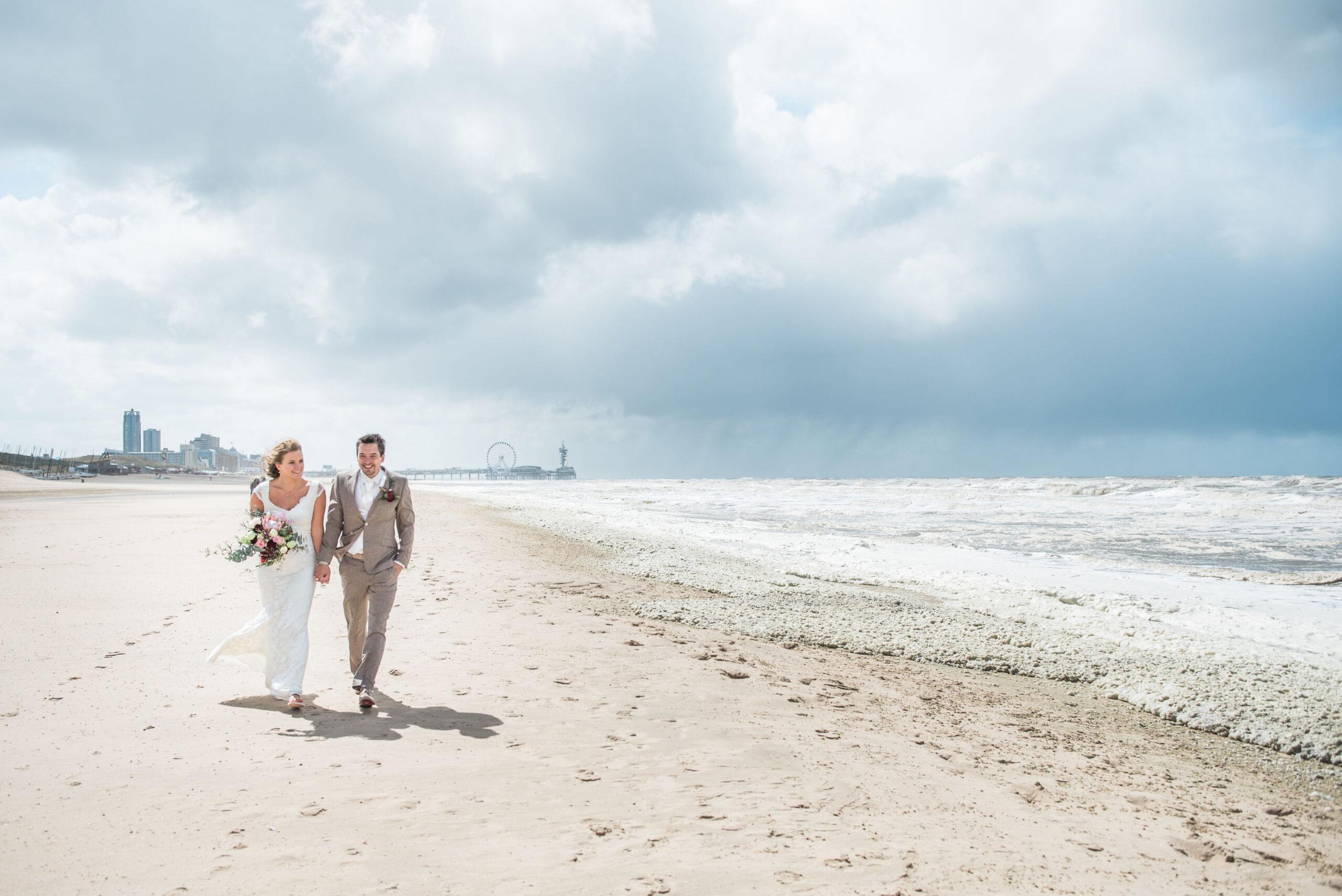 A bride and groom on the beach in Scheveningen