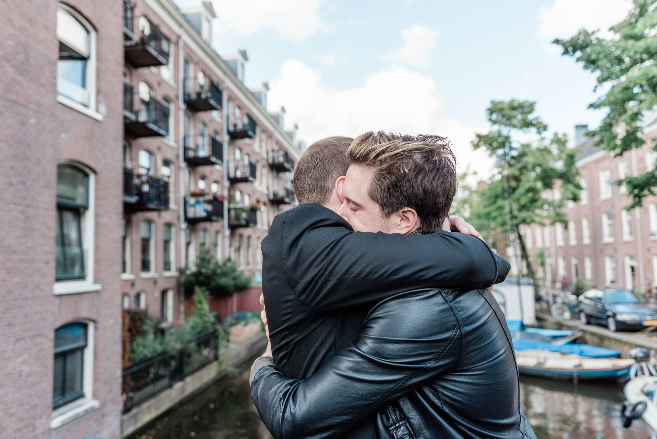 Two guys during their elopement in Amsterdam