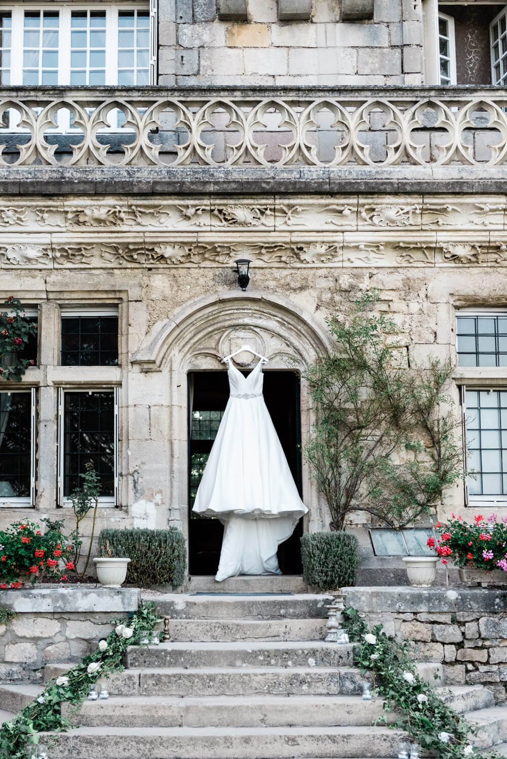 A Stella York wedding dress hanging in the entrance of Chateau d'Hattonchatel in the Lorraine region in France