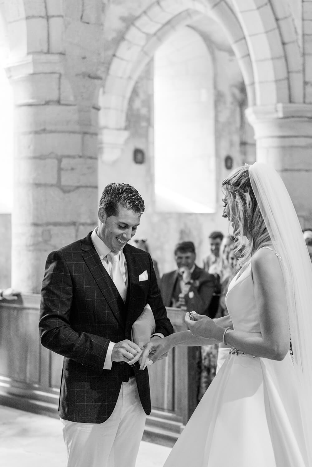 A bride and groom getting married at their destination wedding in a church in France