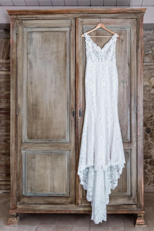 Wedding dress hung on a closet at Hotel Castell d'Emporda