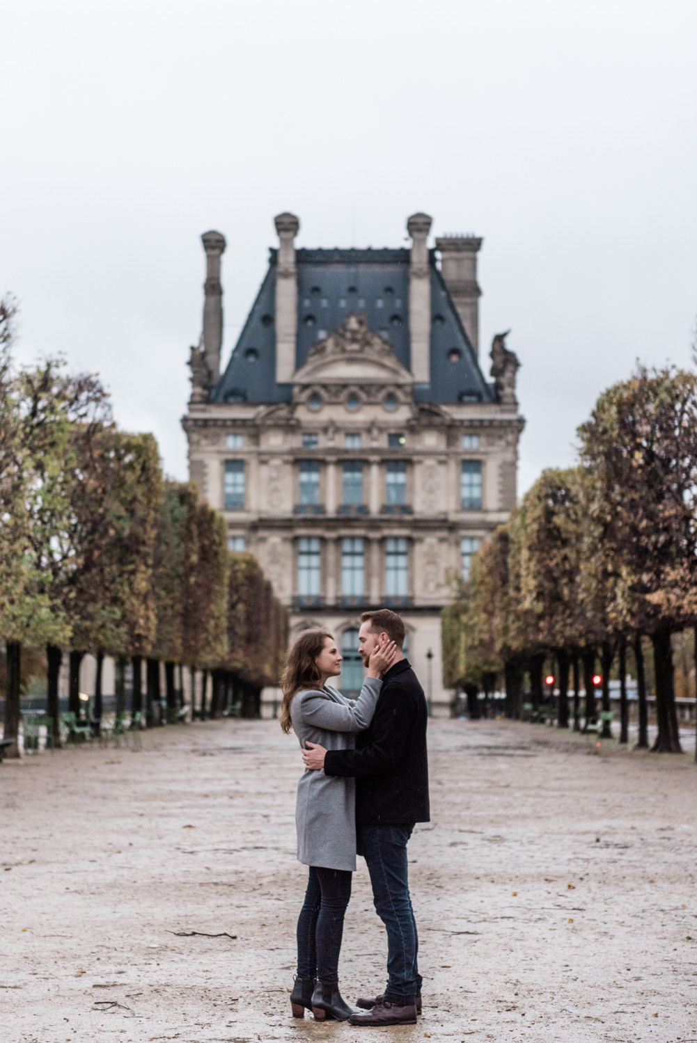 A couple posing at Tuileries Gardens in Paris just after they got engaged