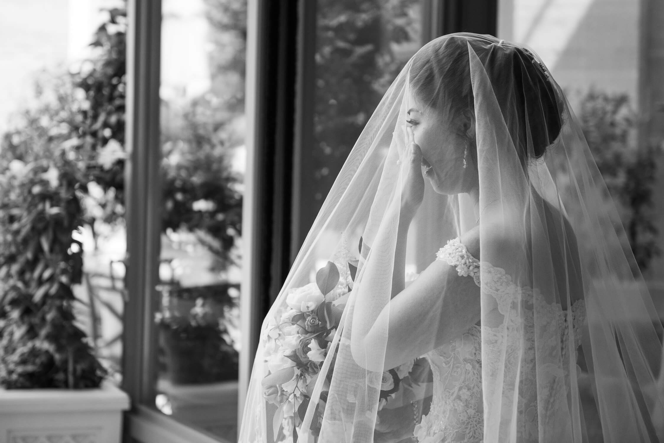 A bride crying at her wedding ceremony at the Ritz