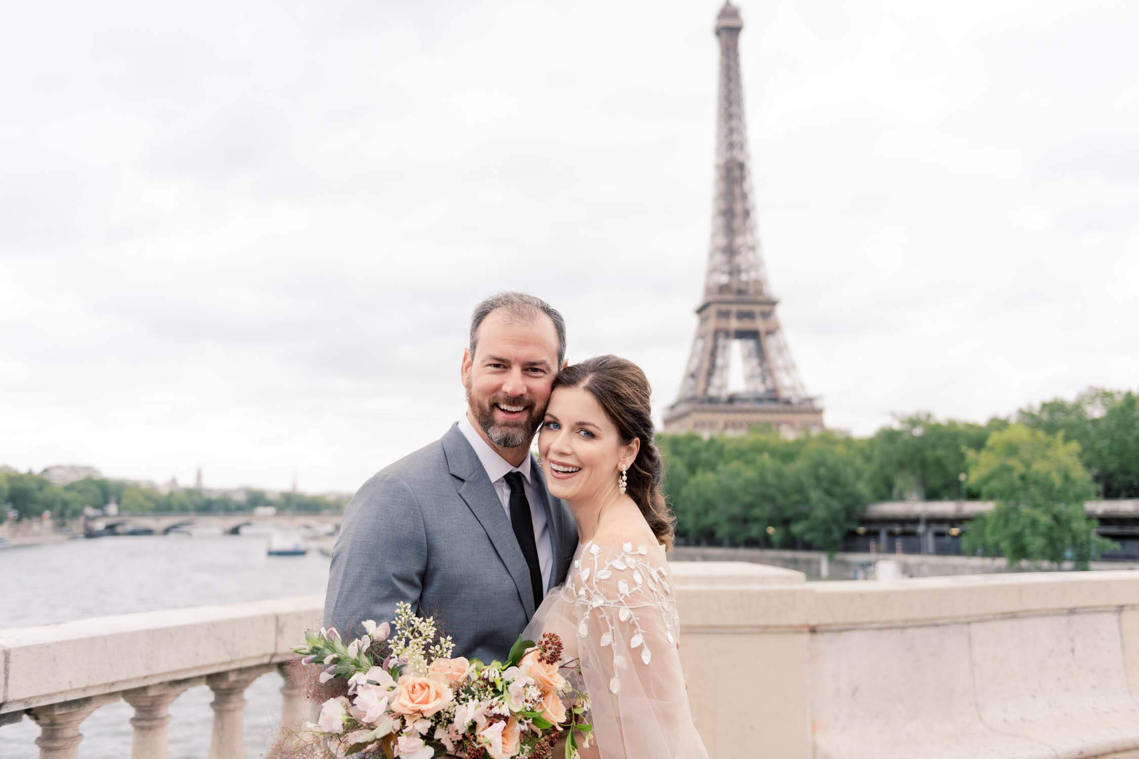 A bride and groom in front of the Eiffel Tower during their elopement in Paris