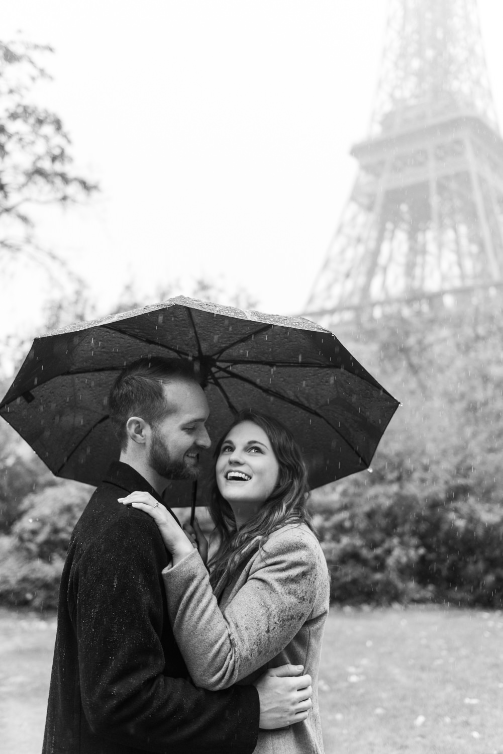 American couple photographed on the foot of the Eiffel Tower, by an English speaking couple shoot photographer in Paris