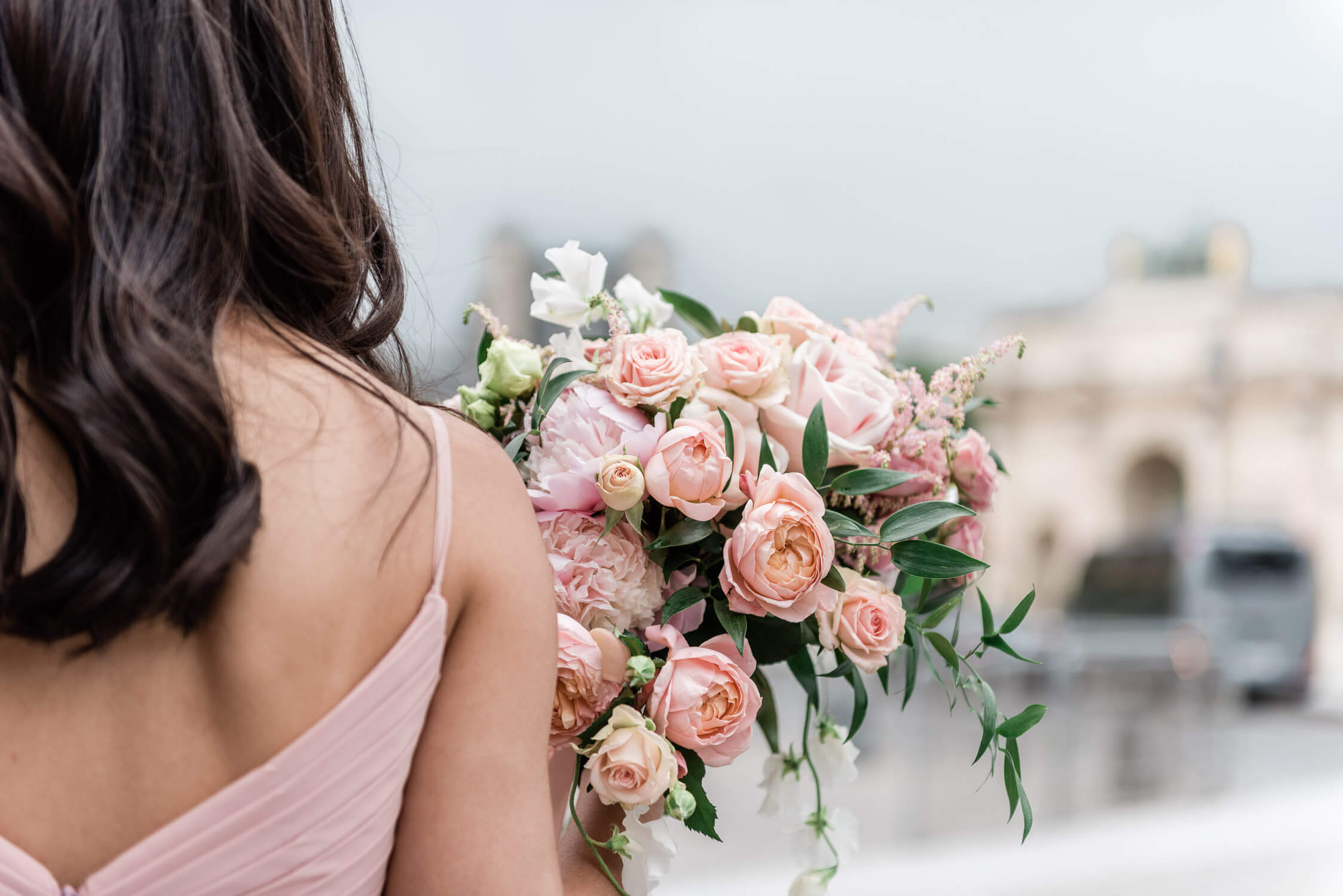 Photojournalistic bridesmaid bouquet shot of an elopement at the Ritz in Paris